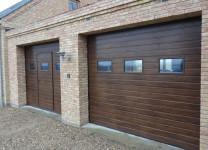 Подъемно-секционные ворота для гаража Алютех